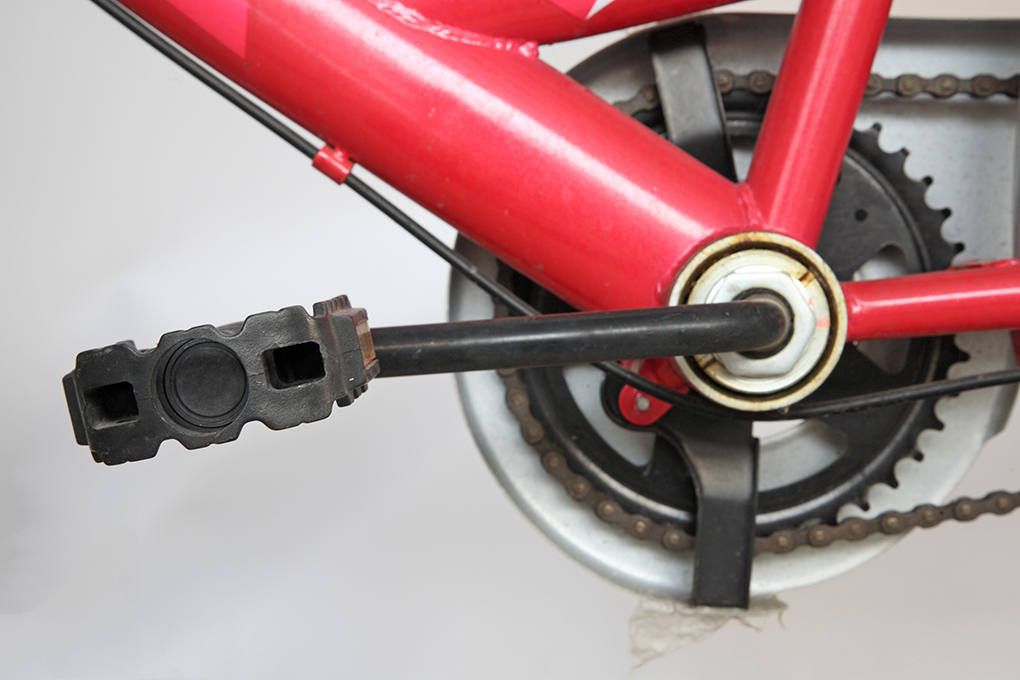 pedal and chain of pink bicycle