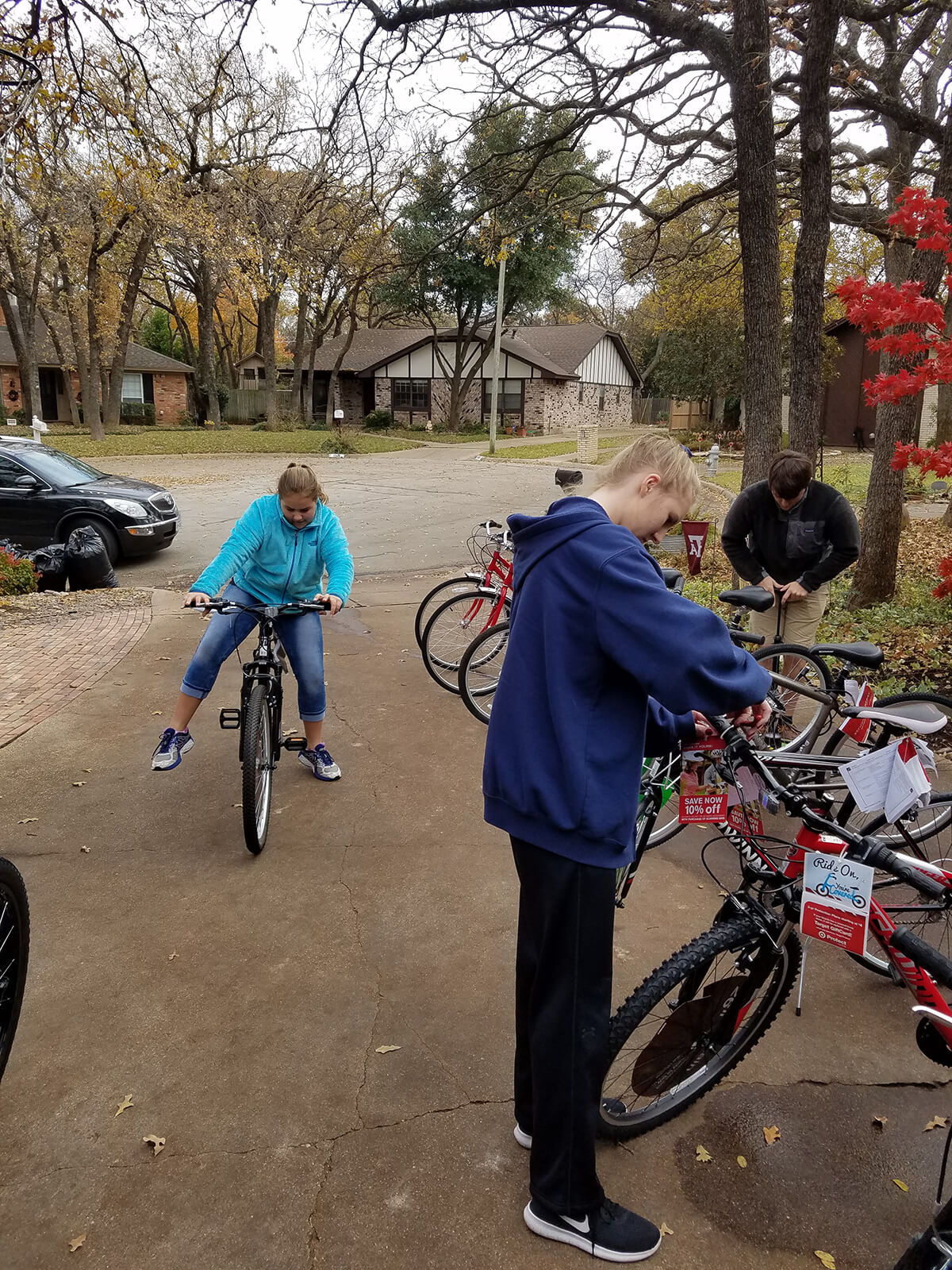 Trey, Audrey and Abby prepping and testing the bikes before delivery