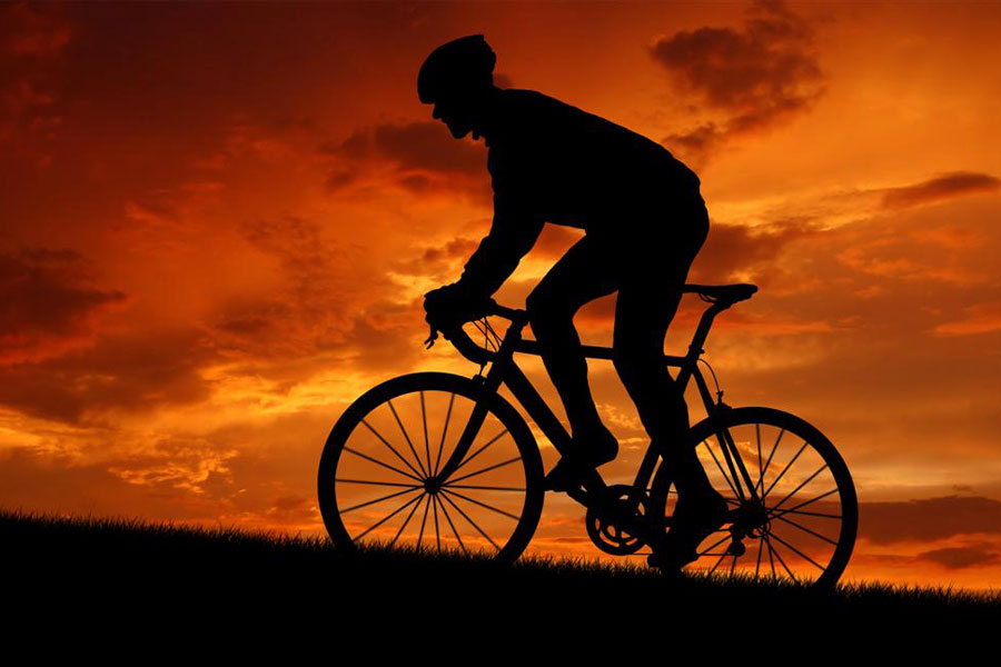 road-cyclist-at-sunset