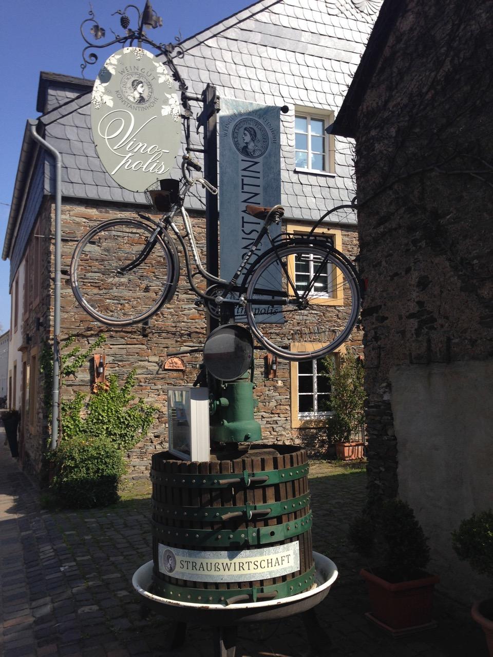 Picture bike at vineyard atop wine press